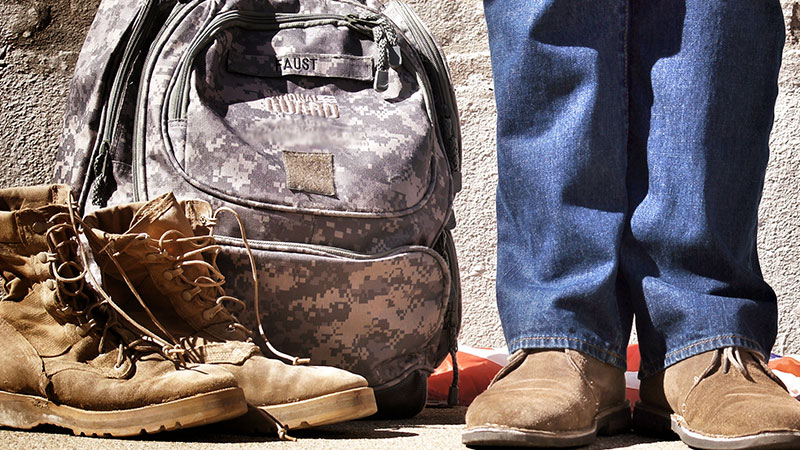 Soldier in civilian clothing with bag